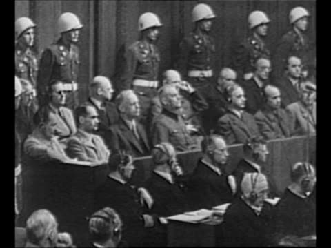 defendant joachim von ribbentrop stands in prisoner's dock, listens to his sentence in nuremberg trials, walks to other side of defendant alfred... - newsreel stock videos & royalty-free footage
