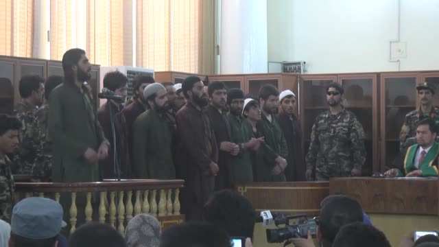 defendants accused of brutal murder of 27year old farkhunda falsely charged with burning a copy of the quran attend their trial at the primary court... - brutal killing stock videos & royalty-free footage