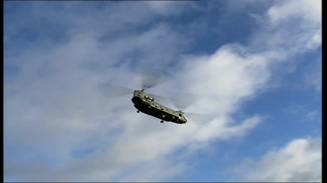 defends prince william's helicopter flight when he landed in girlfriend's garden; london: greenwich: ext ground to air shot of raf chinook helicopter... - raf stock videos & royalty-free footage