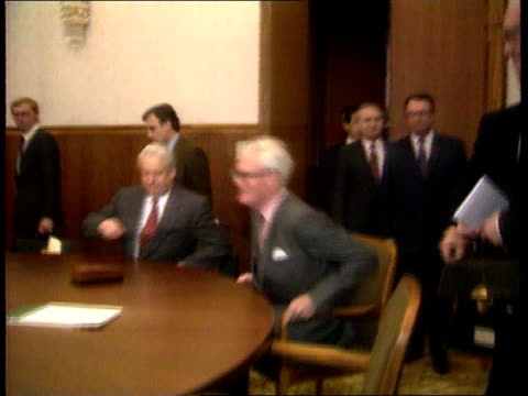 Defense cuts/Foreign aid ITN LIB Douglas Hurd taking seat at table Yeltsin and others for talks on economy TCMS Hurd and Yeltsin sitting PULL OUT...