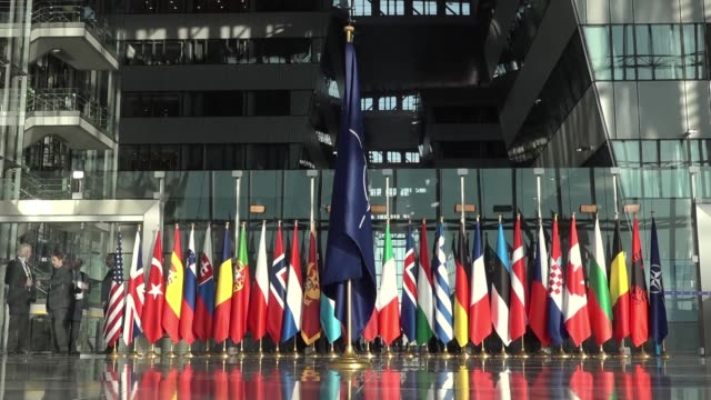 defense ministers arrive at the organisation's headquarters in brussels for a meeting ahead of the munich security conference which will take place... - nato stock-videos und b-roll-filmmaterial