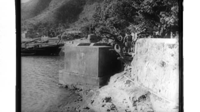 defenses are prepared along the hong kong coast as a british submarine and seaplane operate in that area - 1940 stock-videos und b-roll-filmmaterial
