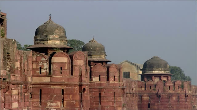 A defensive wall surrounds Agra Fort in India.