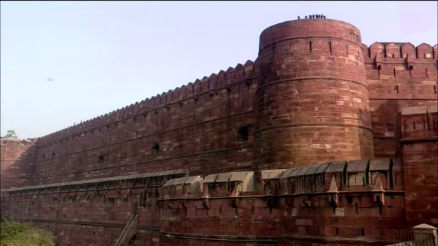 Defensive walls and towers comprise the Agra Fort in India.