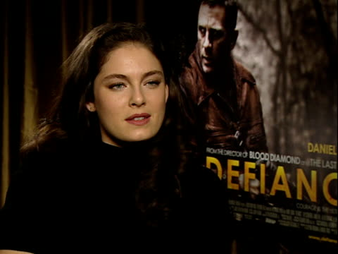 'defiance' film / alexa davalos interview on working with daniel craig not cut out to be bond girl / tom boy at heart on love story in the film plans... - bond girl fictional character stock videos & royalty-free footage
