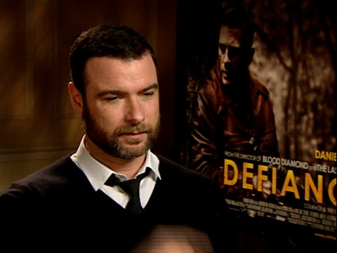 'defiance' film / liev schreiber interview schreiber interview sot on doing russian dialogue in film on getting on with jamie bell and daniel craig... - daniel craig stock videos and b-roll footage
