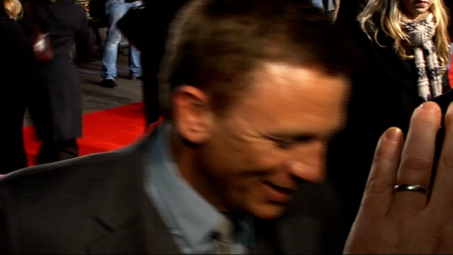 arrivals craig interviewed by press on red carpet sot/ poster for 'defiance' / daniel craig signing autographs for fans - daniel craig stock videos and b-roll footage