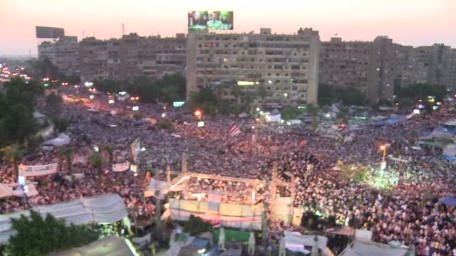 a defiant supreme guide of the muslim brotherhood vowed friday his movement would stay on egypts streets in their millions until mohamed morsi is... - coup d'état stock videos & royalty-free footage