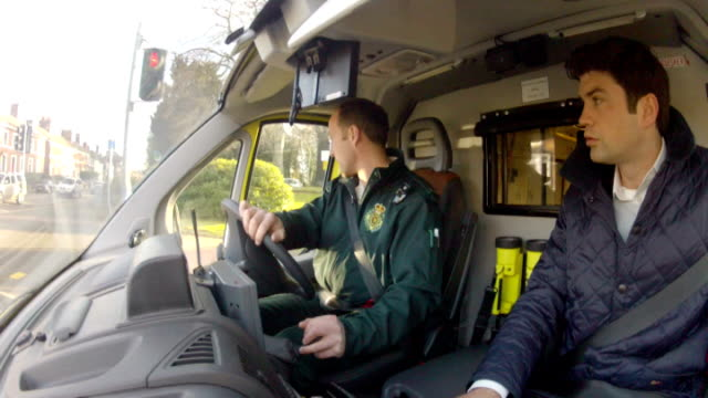 second special report Mark King interview SOT saw ambulance and my heart sank POV through front window of ambulance as driving fast on emergency call...