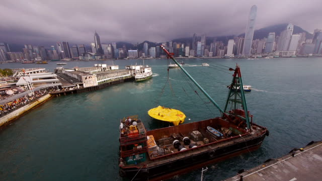 Deflated Rubber Duck in Hong Kong with Port and Skyline in BG