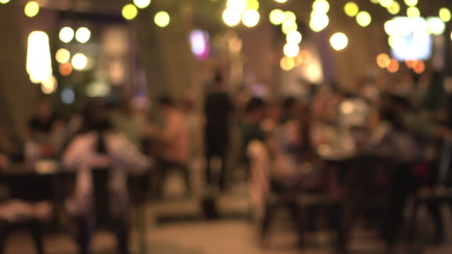defocus nightlife in yellow light background - restaurant stock videos & royalty-free footage