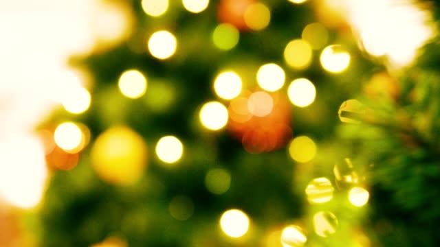 defocus of christmas tree on december - december stock videos & royalty-free footage