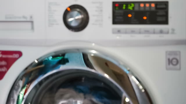 defocus of washing machine - launderette stock videos & royalty-free footage