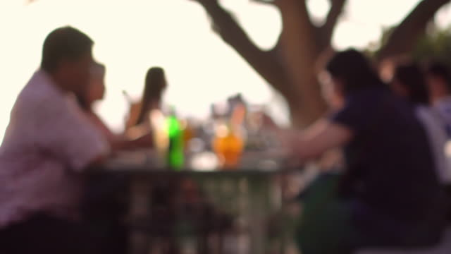 defocus people enjoy drink outdoor - unrecognisable person stock videos & royalty-free footage