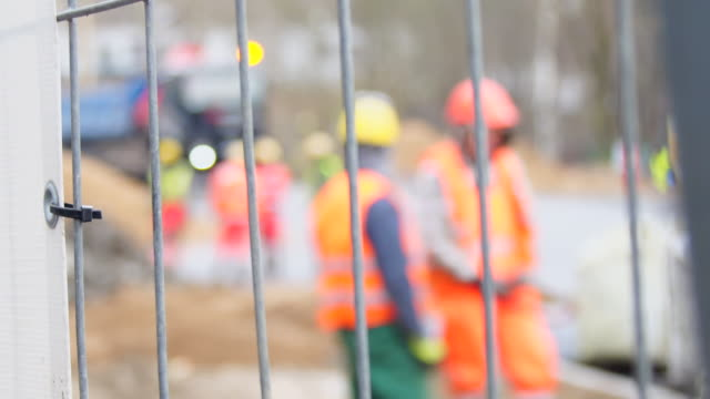 defocus unrecognizable construction workers - boundary stock videos & royalty-free footage