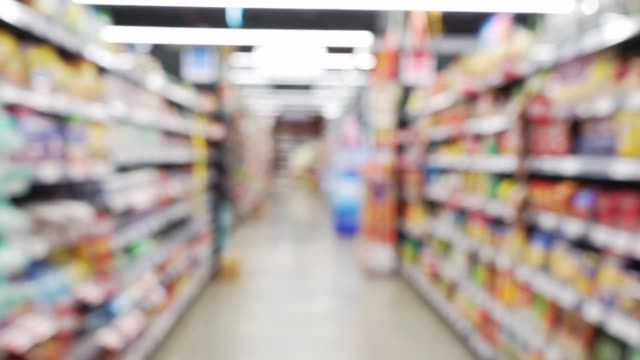defocus walk in supermarket - market retail space stock videos & royalty-free footage