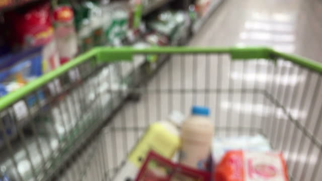 de-focused abstract background ,walking with shopping cart - full stock videos and b-roll footage