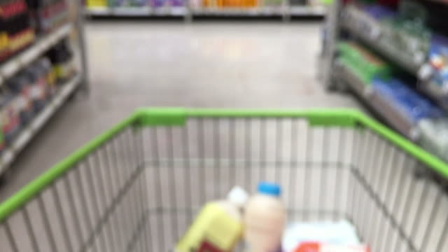 de-focused abstract background ,walking with shopping cart - trolley stock videos and b-roll footage