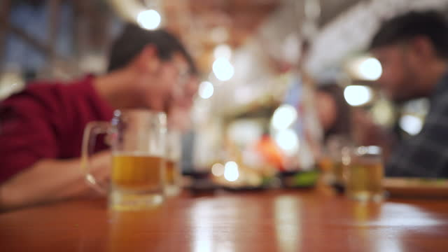 defocused - afterwork dining with beer - after work stock videos & royalty-free footage