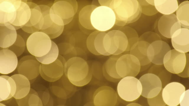 defocused and blur image of garland of gold led lights - christmas lights stock videos & royalty-free footage