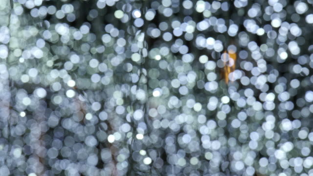 Defocused and blur image of garland of white led lights