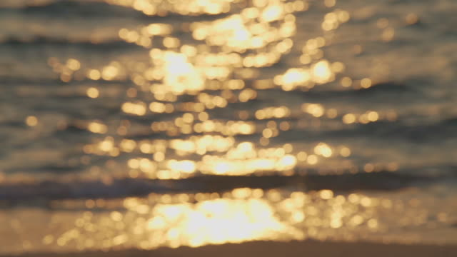 slo mo defocused bokeh golden reflection wave sea beach at sunset or sunrise in pattaya, thailand - wave pattern stock videos & royalty-free footage