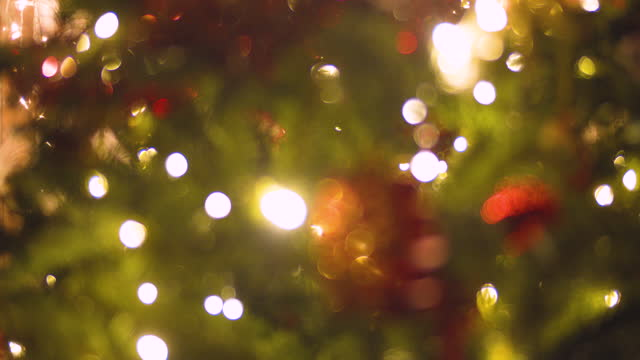 defocused christmas tree background with blinking lights - fairy lights stock videos & royalty-free footage