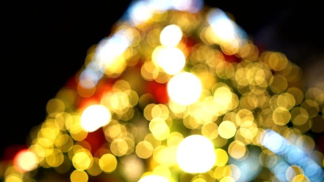 defocused christmas tree. - tilt down stock videos & royalty-free footage