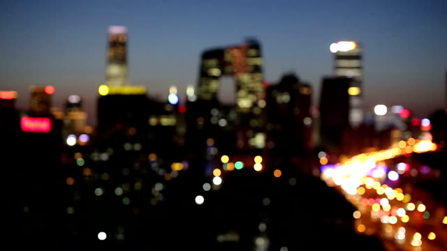 defocused city night,beijing,china - unscharf gestellt stock-videos und b-roll-filmmaterial