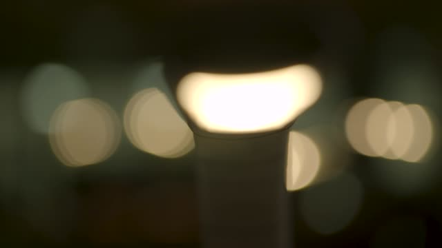 defocused close view of reading light turning on and off - audio available stock videos & royalty-free footage