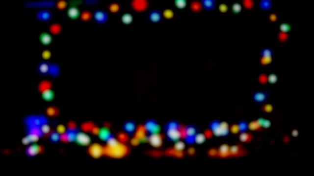 Defocused Colored Lights Blinking On Black Background