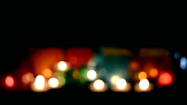 defocused colored lights on black background - cemetery stock videos & royalty-free footage