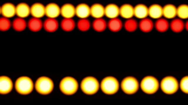 defocused colored lights on  black background - circus stock videos & royalty-free footage