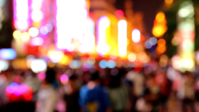 defocused crowded street - commercial sign stock videos and b-roll footage