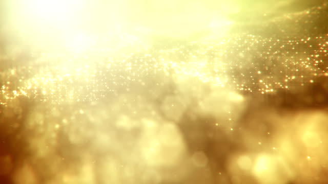 defocused gold particles 2 - loopable - yellow stock videos & royalty-free footage