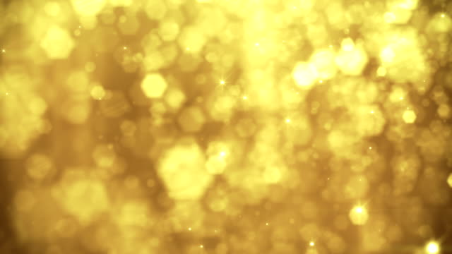 defocused gold particles - loopable - gold colored stock videos & royalty-free footage