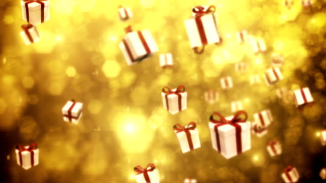 defocused gold particles with gift boxes - loopable - christmas gift stock videos and b-roll footage