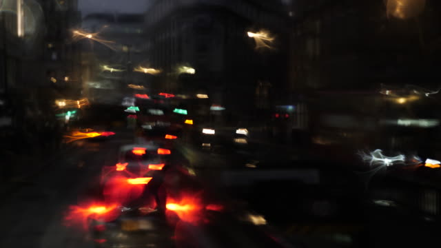 defocused headlights and city lights from bus window on a rainy day - road signal stock videos & royalty-free footage