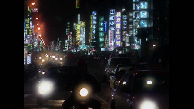 tu defocused headlights moving along taipei street; 1996 - fade out stock videos & royalty-free footage