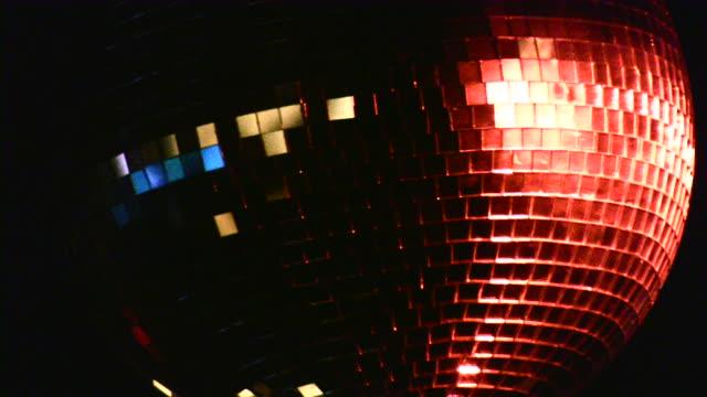 defocused lighting equipment: disco ball, garland, decorations, running lights. - mirror ball stock videos & royalty-free footage