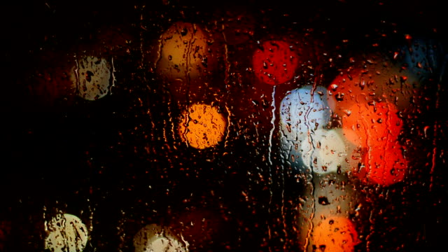 defocused lights behind raindrops - windshield stock videos & royalty-free footage