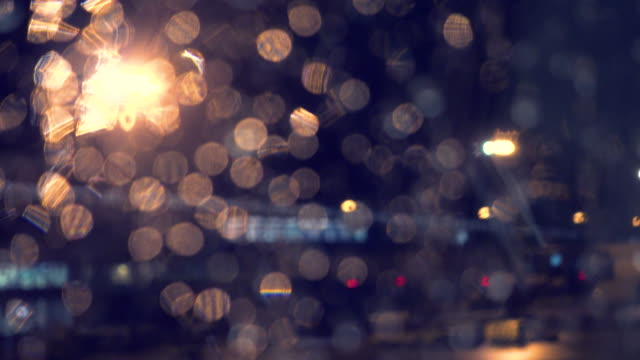 defocused lights behind raindrops - light natural phenomenon stock videos & royalty-free footage