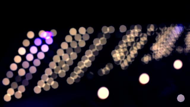 デフォーカスライトを点滅黒色の背景 - サウンドトラック点の映像素材/bロール