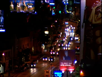 defocused lights of traffic on sunset strip traffic including white limousine track from car past chateau marmont sign neon signs for roxy and rainbow nightclubs los angeles - sunset boulevard los angeles stock videos & royalty-free footage