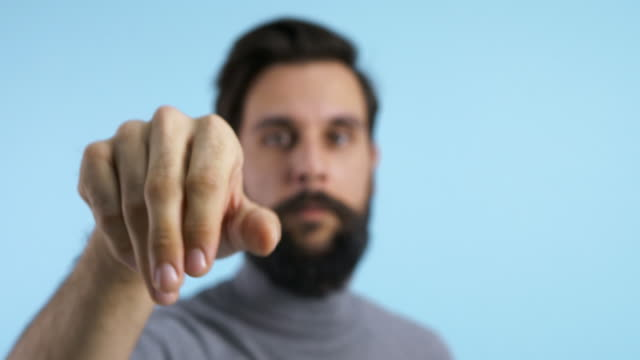 vidéos et rushes de defocused man pretending to use an invisible screen/ debica/ poland - invisible