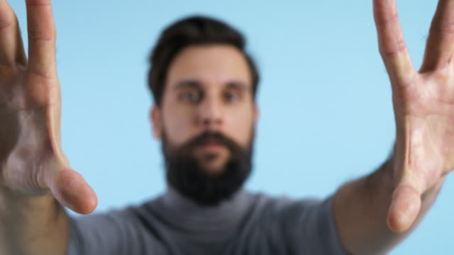 defocused man using invisible touch screen - interactivity stock videos & royalty-free footage
