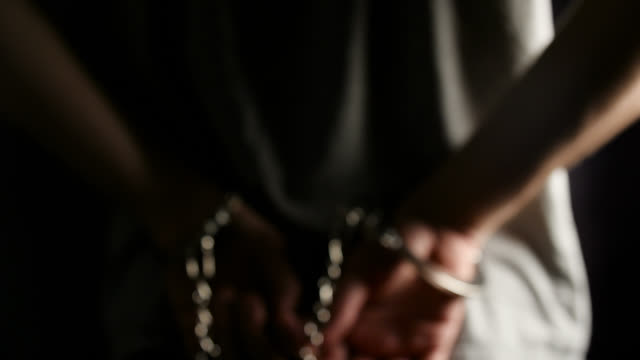 defocused mid shot of man in handcuffs - male likeness stock videos & royalty-free footage