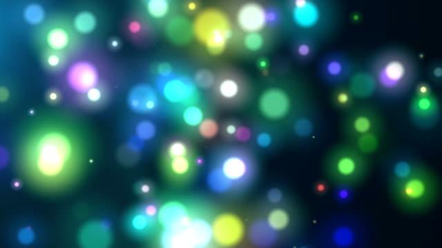 離焦模糊的多有色粒子背景 - 鮮明顏色 個影片檔及 b 捲影像