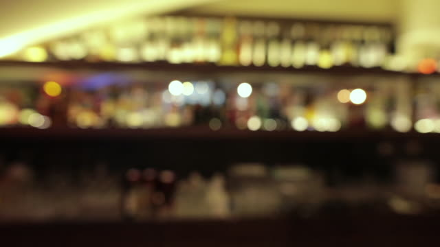 defocused night club bar. bokeh light background - pub stock videos & royalty-free footage