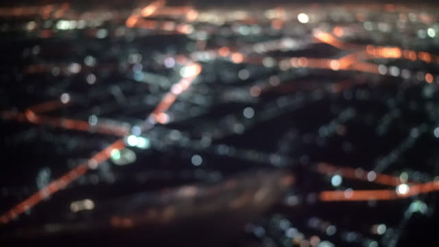 defocused of airplane window view and light city illuminated of night flight - aircraft wing stock videos & royalty-free footage